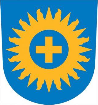 Espoon hiippakunnan vaakuna, keltainen risti keltaisen auringonkehän keskellä sinisellä pohjalla